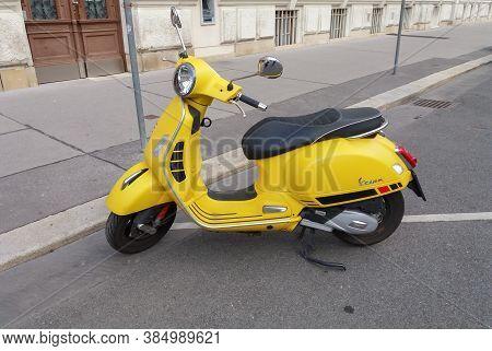 Vienna, Austria - Circa September 2018: Yellow Italian Vespa Scooter Motorcycle