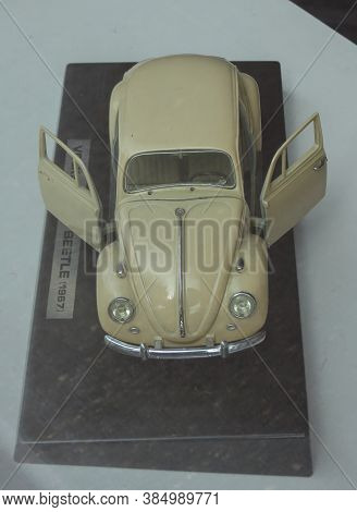 Oslo, Norway - Circa August 2017: Off White Volkswagen Beetle Car Scale Model Produced As Children T