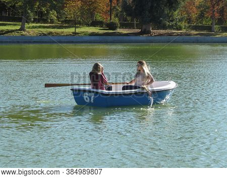 Madrid, Spain - Circa October 2017: Unidentified Girls On A Boat At The Retiro Park Lake
