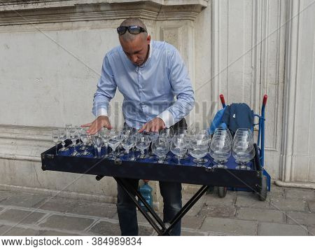 Venice, Italy - Circa March 2018: Unidentified Musician Playing A Glass Harp (also Called Musical Gl