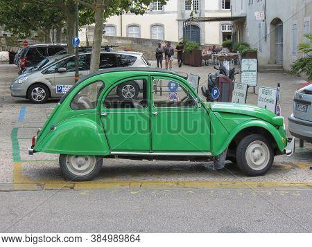 Carcassonne, France - Circa August 2018: Green Citroen 2cv Car