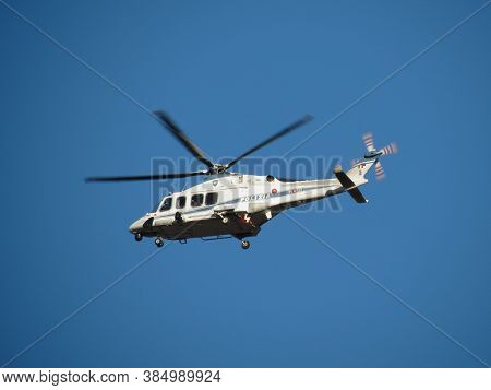 Rome, Italy - Circa December 2018: Police (polizia) Helicopter Rotor Craft Flying In The Sky