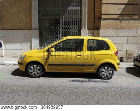 Valletta, Malta - Circa May 2019: Yellow Hyundai Getz Car