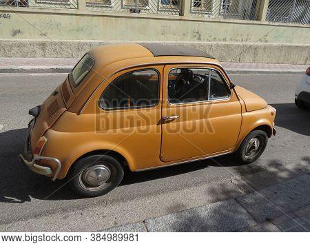 Cagliari, Italy - Circa October 2019: Orange Fiat 500 Car