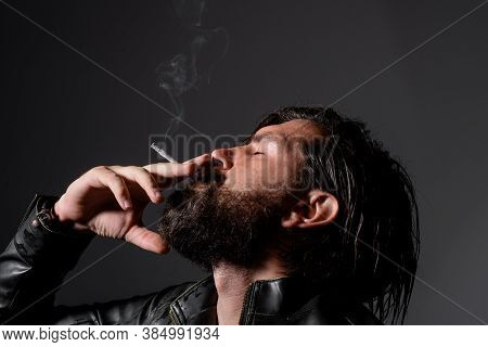 Handsome Man Smoke The Cigarette. Hipster With Cigarette. Cigarette Smoke. Sensual Man Smoking. Toba