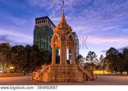 The Yeay Penh Statue Near Wat Phnom In Phnom Penh, Cambodia, With High Rise Apartments Behind. Accor