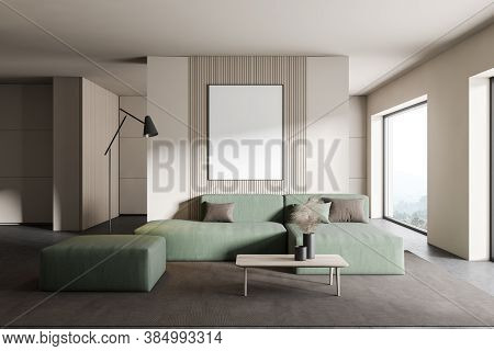 Interior Of Modern Living Room With White Walls, Concrete Floor, Green Sofa And Vertical Mock Up Pos