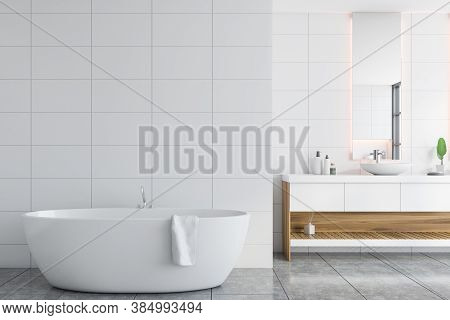 Interior Of Stylish Bathroom With White Walls, Tiled Floor, Comfortable Bathtub And Double Sink. 3d