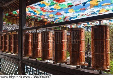 Lijiang, China - April 28, 2019: Prayer Wheels In Yufeng Temple. According To The Tibetan Buddhism S