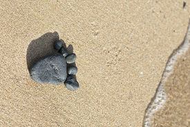 Stone Footprint On Sand
