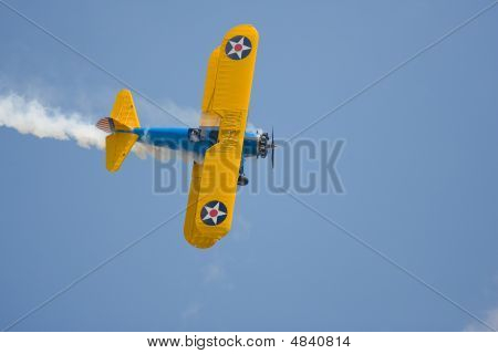 A Pre-wwii Trainer Preforming Stunts At An Airshow