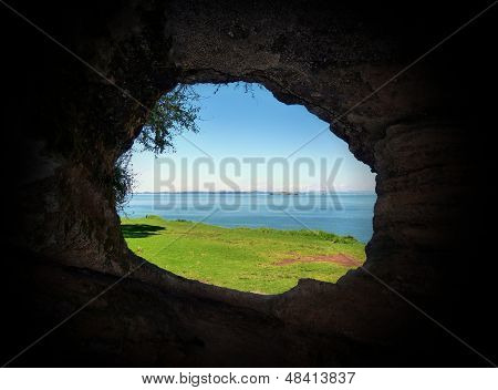 View through the loophole of a historical defense post cave