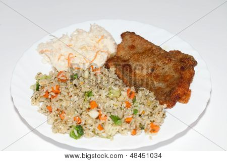 Brown rice with fisch and vegetable. The healthy diet