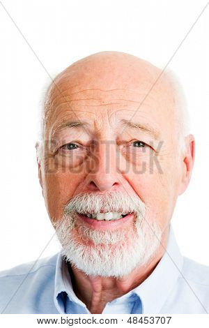 Closeup head shot portrait of handsome senior man.  White background.