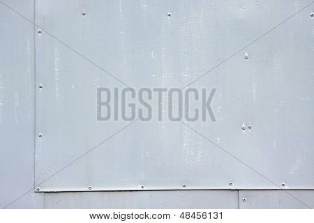 riveted gray steel background with space for text poster