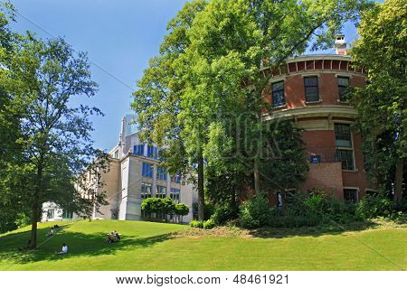 Brussels, Belgium, Park Leopold, people relaxing on the grass, sunny summer day