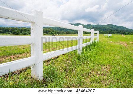 Fence In Farm Field With Cloudy