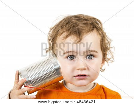 Child With Tin Can Phone Looking To Camera