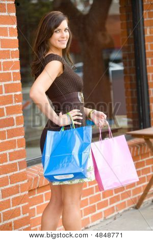 Attractive Young Woman Out On The Town Shopping