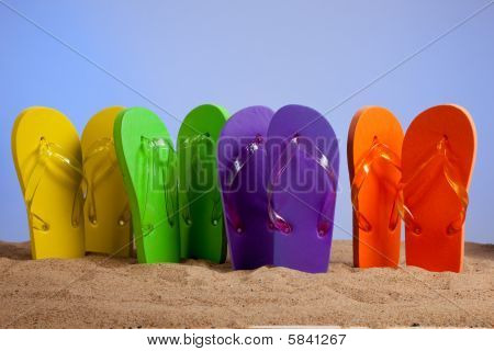 Colorful Flip-flop Sandals On A Sandy Beach