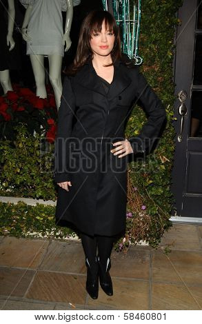 Rose McGowan Holiday Window Lighting to benefit the Kanye West Foundation Loop Dreams Program, Stella McCartney Boutique, Los Angeles, CA, December 5, 2006.