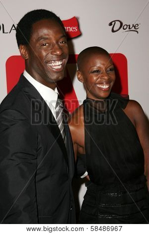 HOLLYWOOD - AUGUST 27: Isaiah Washington and wife Jenisa at the TV Guide Emmy After Party August 27, 2006 in Social, Hollywood, CA.