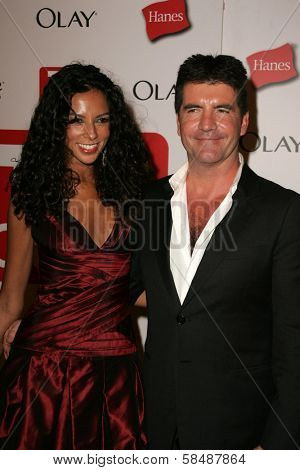 HOLLYWOOD - AUGUST 27: Terri Seymour and Simon Cowell at the TV Guide Emmy After Party August 27, 2006 in Social, Hollywood, CA.