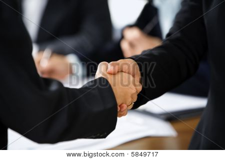 Handshake Between Two Businesswoman