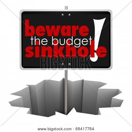 Beware the Budget Sinkhole words sign hole, crack chasm symbolize money trouble