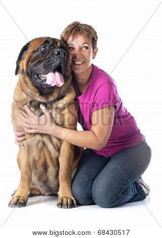 female mastiff and woman in front of white background poster