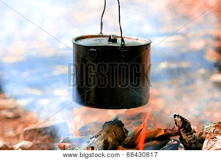 smoked tourist kettle over camp fire