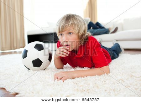 Animated Boy Watching Football Match Lying On The Floor