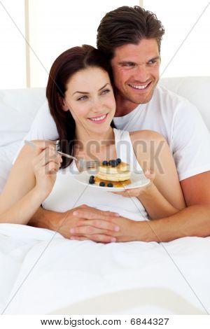 Joyful Couple Having Breakfast