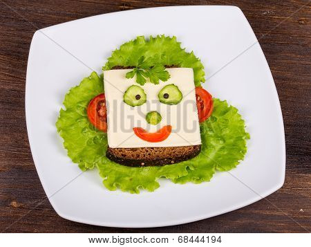 Face On Bread, Made From Cheese, Lettuce, Tomato, Cucumber And Pepper