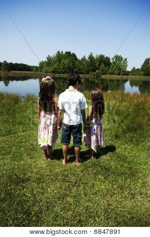 3 children in a garden