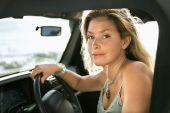 Blonde Woman Sitting In Car