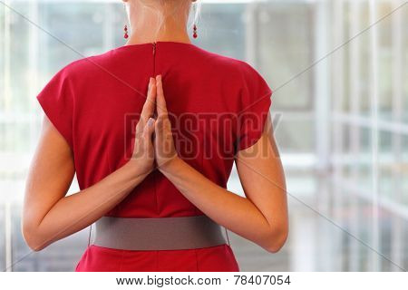 Fit woman - namaste gesture on back - close up poster