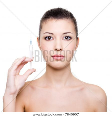 Beautiful Woman Holding Medical Syringe