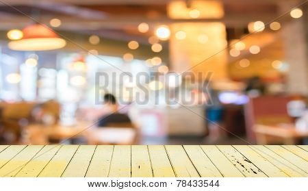 Empty Wood Table And Blurred Coffee Shop  Background.