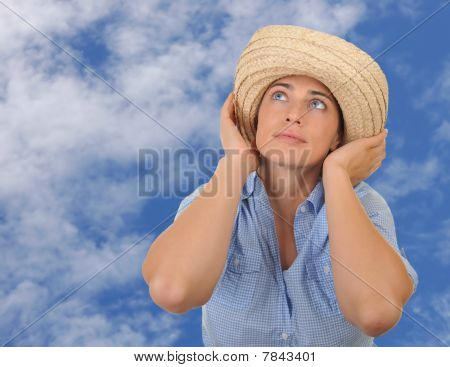 Young woman surrounded by sky.
