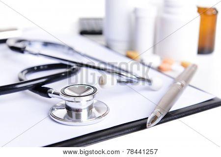 Stethoscope on light background