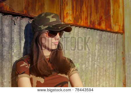 Meditative Young Woman Soldier in Camouflage Outfit