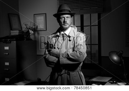 Film Noir: Detective Holding A Revolver And Posing
