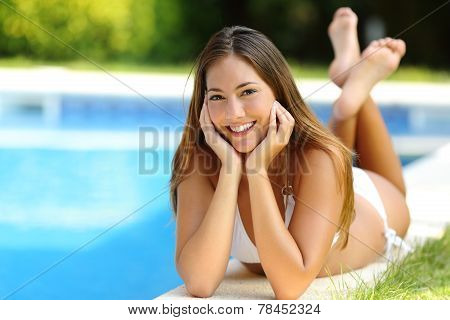 Happy Girl Posing Wearing Bikini On A Pool Side In Summer Vacations