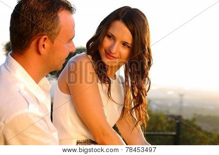 Young Romantic Couple Eye Contact At Sunset