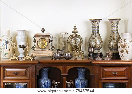 Various antique clocks vases and candlesticks on display