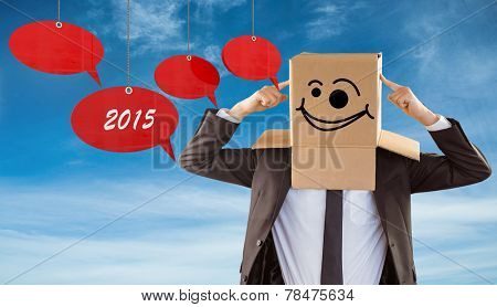 Anonymous businessman pointing to box against blue sky