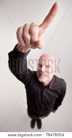 Finger Of A Man Telling Off In Wide Angle