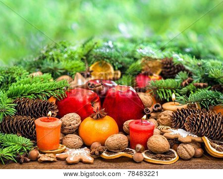 Christmas Decoration With Candles, Cookies And Fruits