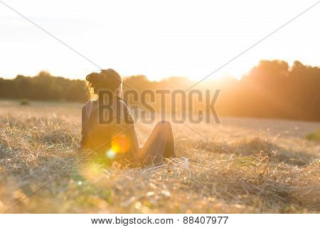 beautiful young woman or girl on meadow